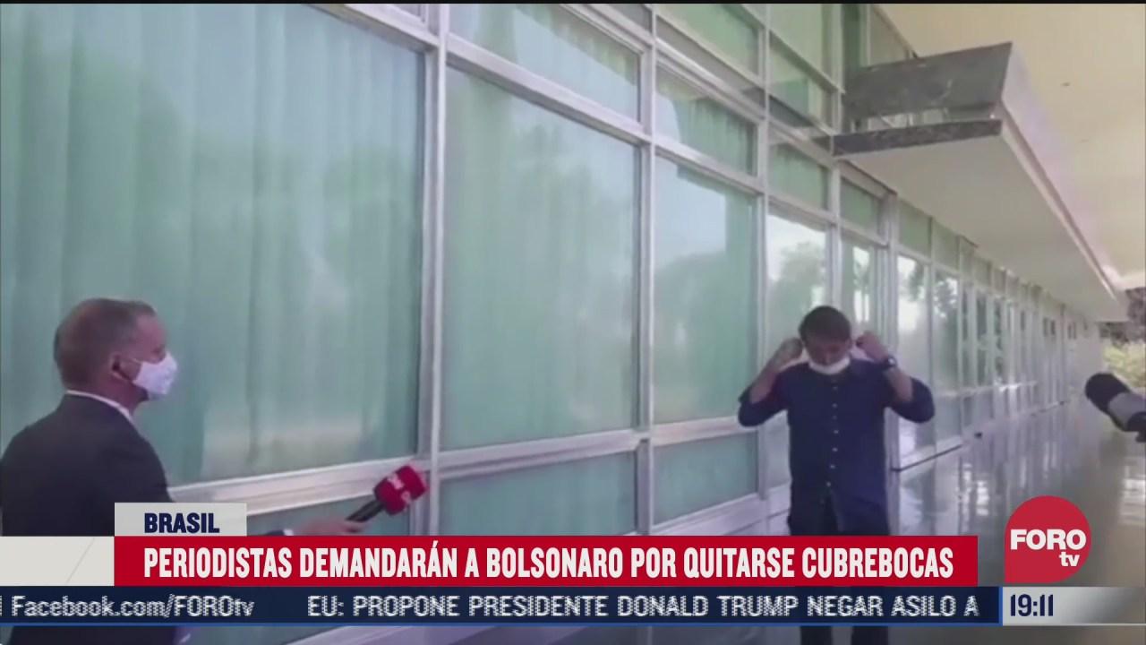 Jair Bolsonaro se quita el cubrebocas contagiado de coronavirus frente a periodistas y ellos lo demandan