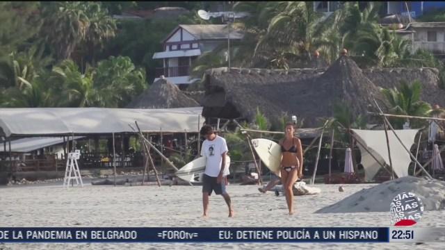 FOTO: 12 de julio 2020, se normaliza practica de surf en puerto escondido