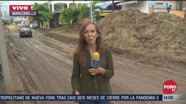 lluvia en manzanillo complica labores de limpieza