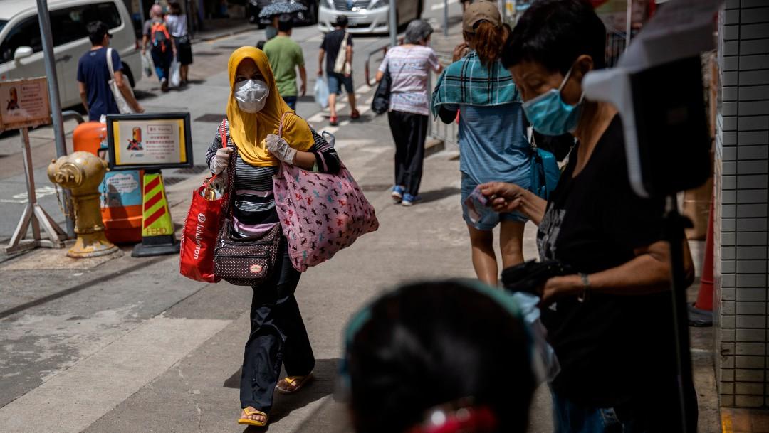 Personas en calles de Hong Kong