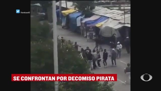 Enfrentamiento en operativo contra la piratería en Puebla