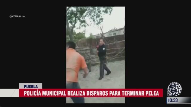 policia dispara para detener una pelea en puebla