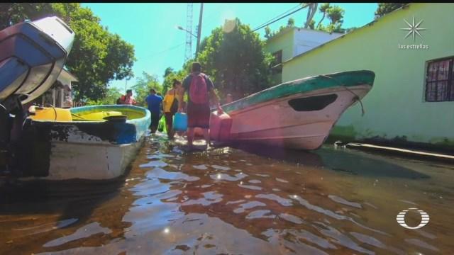 afectados por inundaciones en tabasco padecen la falta de servicios de salud