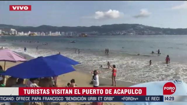 turistas arriban a playas de acapulco guerrero