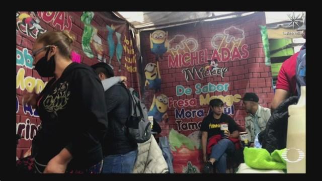 decenas se reunen en chelerias del barrio de tepito