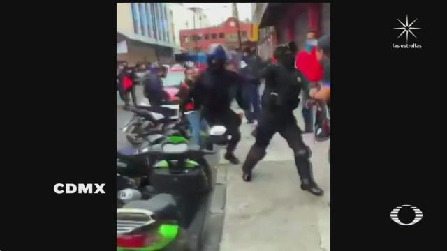 durante un enfrentamiento policia golpea a comerciante en cdmx