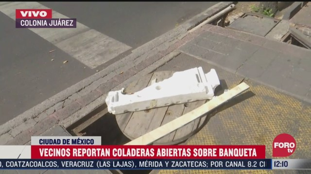 vecinos reportan coladeras abiertas sobre banqueta en colonia juarez cdmx