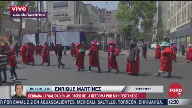 manifestantes marchan sobre paseo de la reforma cdmx