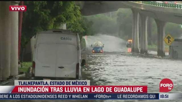 colapsa el trafico en lago de guadalupe por inundaciones