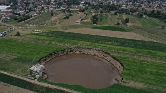 Ejidatarios podrían perder sus cosechas de maíz que están cercanas al socavón en Puebla
