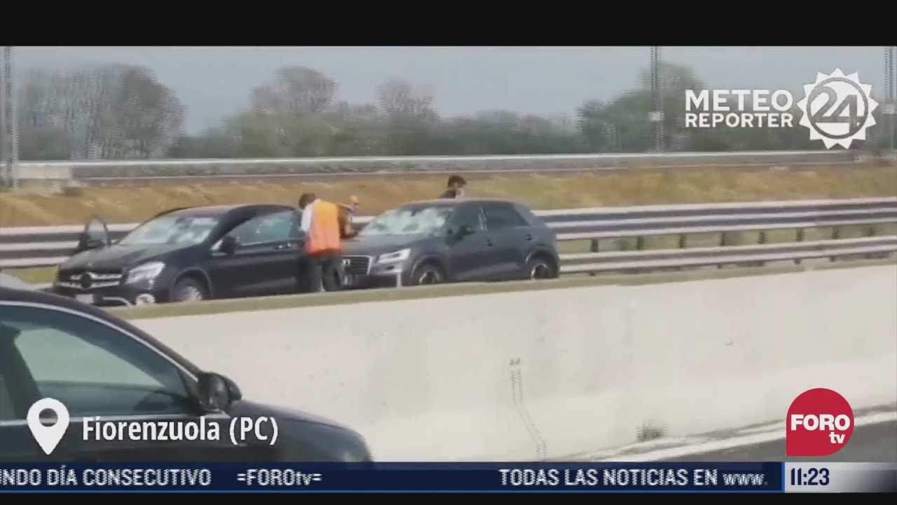 granizada causa danos a decenas de vehiculos en carretera de italia