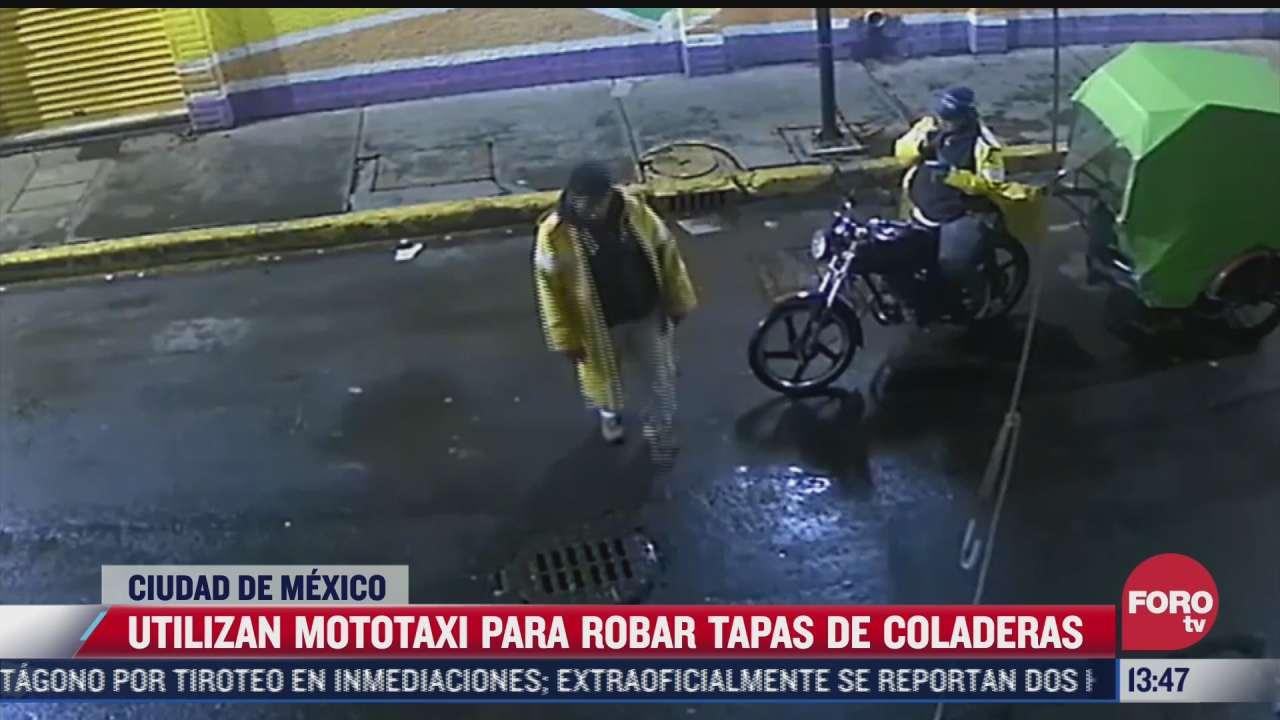 utilizan mototaxi para robar tapas de coladeras en cdmx