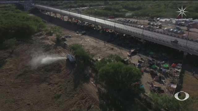 migrantes haitianos desalojan campamento en del rio texas