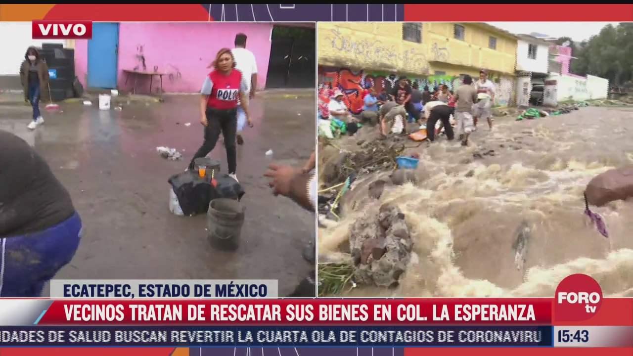 vecinos tratan de rescatar sus bienes en la colonia esperanza en ecatepec
