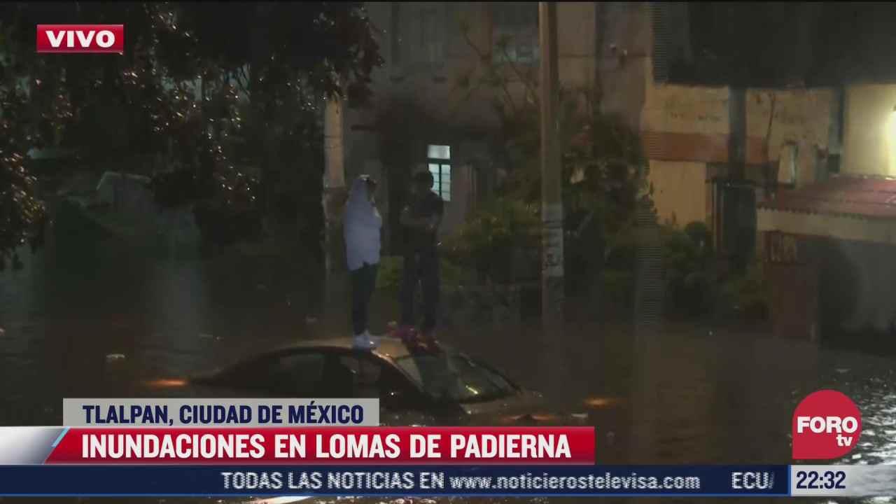 video quedan 2 jovenes atrapados tras inundacion en tlalpan
