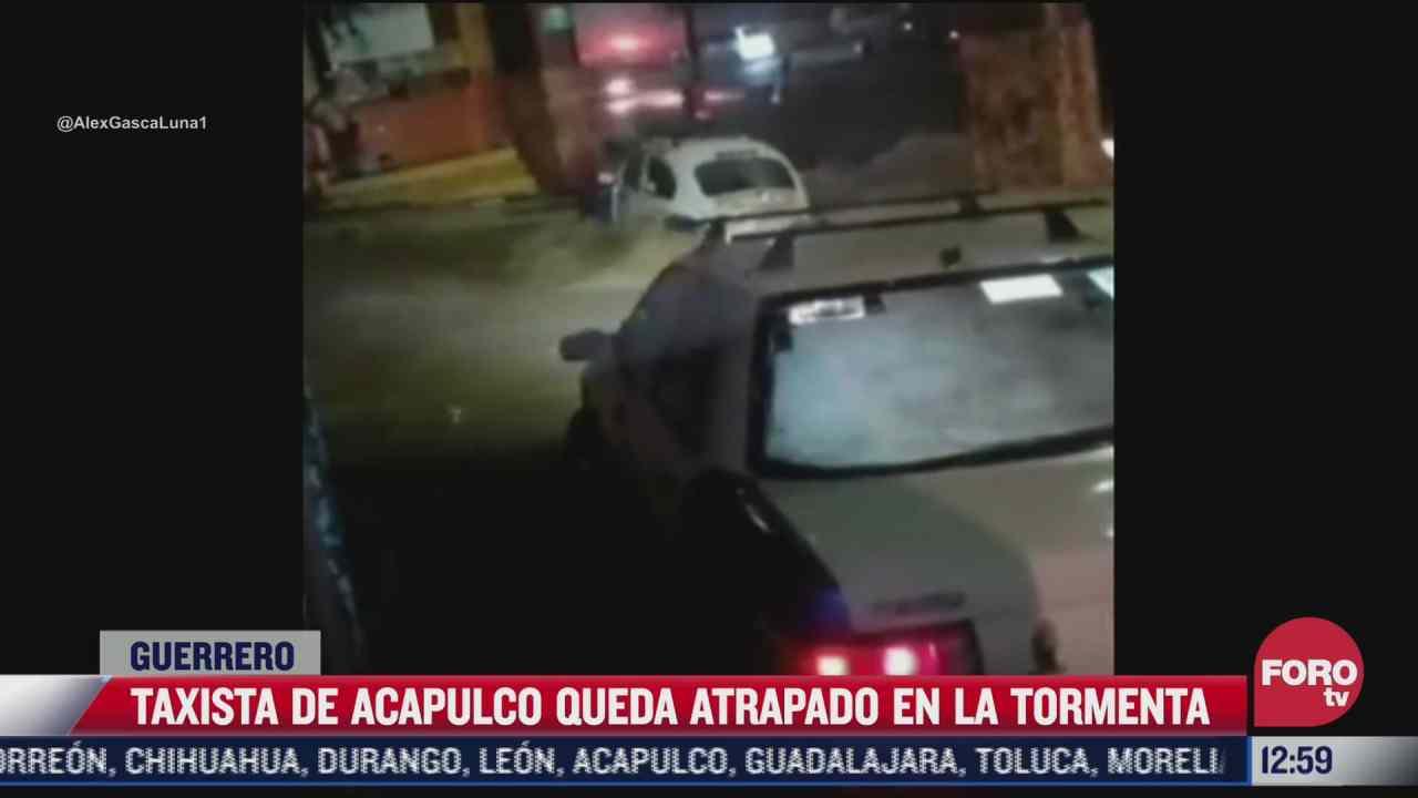 video taxista de acapulco queda atrapado en tormenta