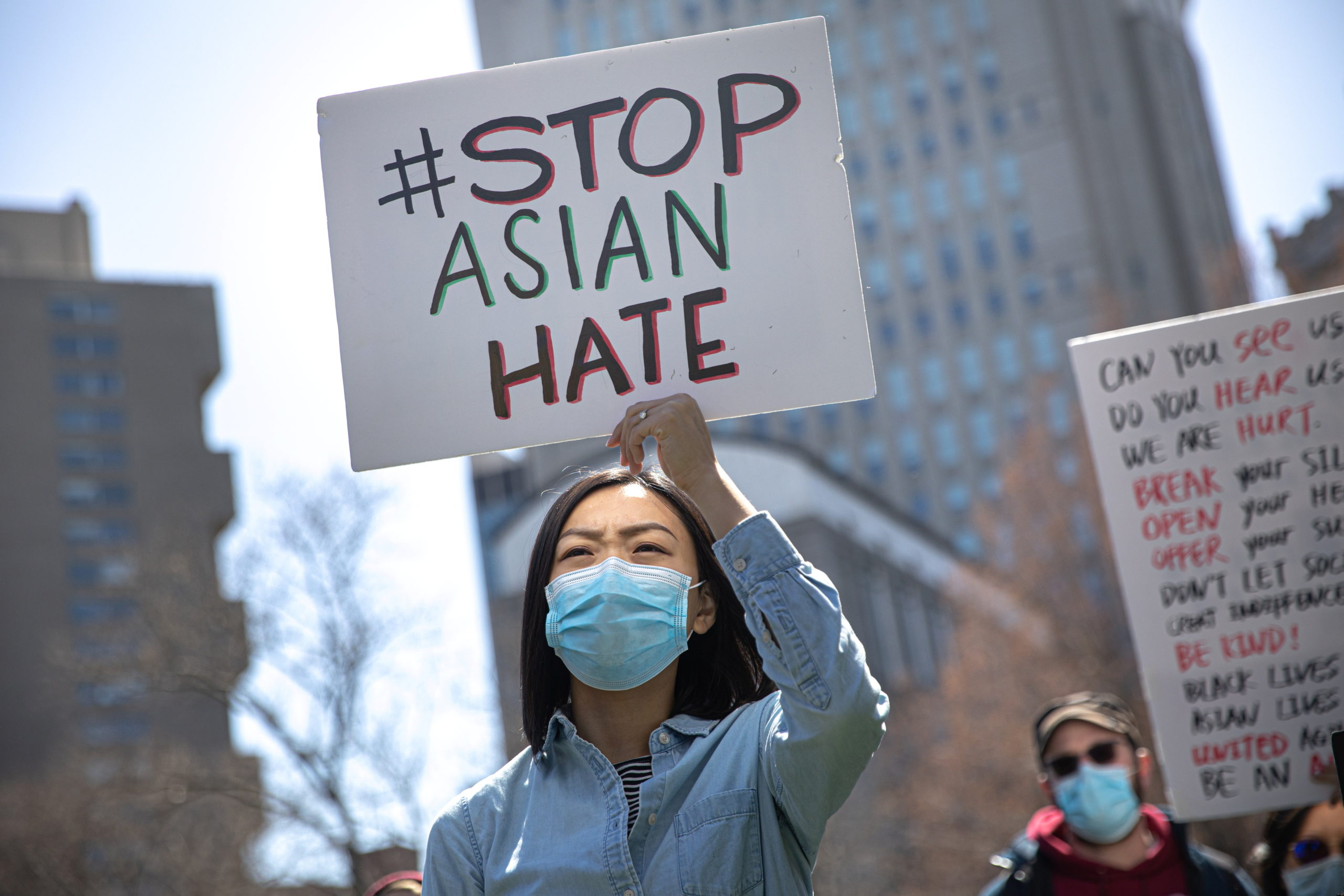 A woman holds a placard as she participates in a Stop Asian Hate rally at Columbus Park in New York City, U.S., April 3, 2021.