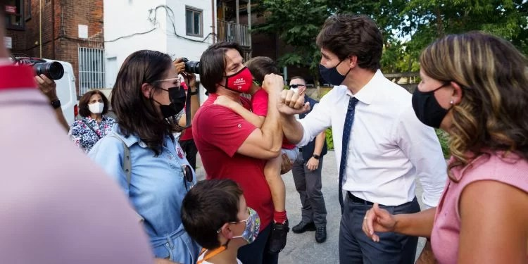 Justin Trudeau greets supporters while campaigning