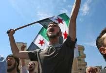 Siriani protestano contro bombardamenti