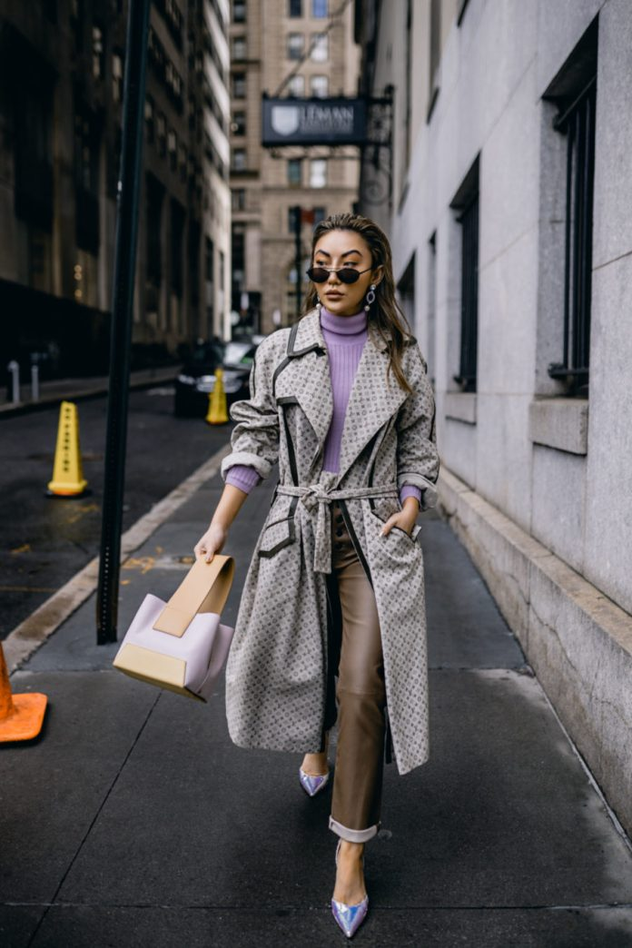 Jessica Wang wearing a patterned duster coat, a purple turtleneck sweater, leather pants, and holographic pumps by amina muaddi // Jessica Wang - Notjessfashion.com