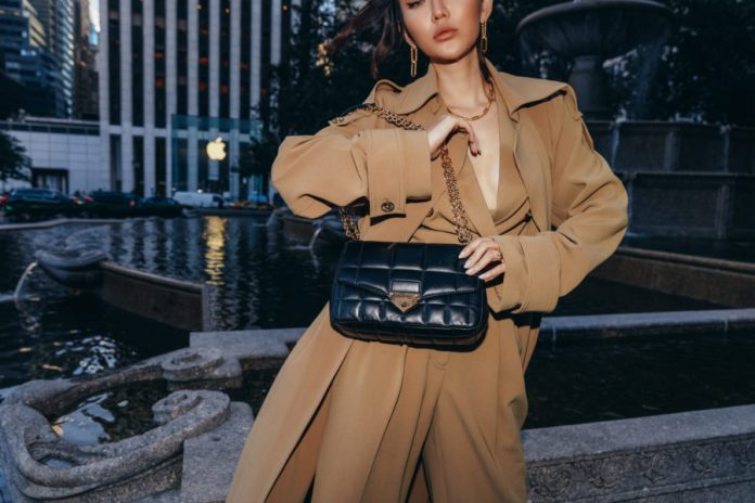 Jessica Wang wearing a camel monochromatic outfit - duster coat, wrap top, trousers - with a quilted handbag featuring prada // Jessica Wang - Notjessfashion.com