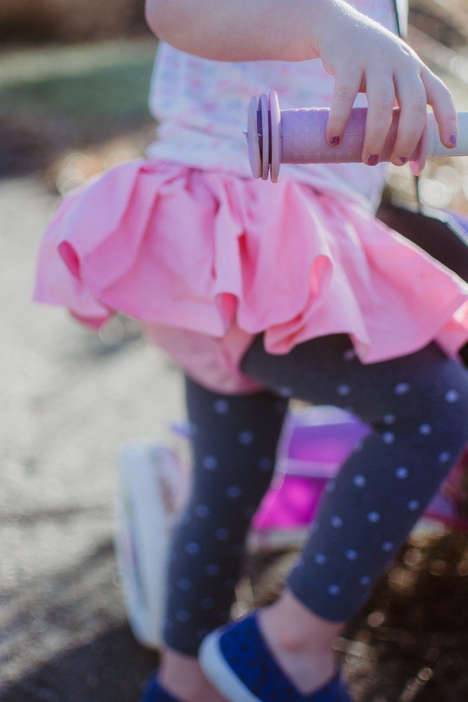 lifestyle blogger | lifestyle | toddler fun | kid fashion | outdoor play | get kids outside | toddler on bike | kid riding bike | handmade clothes | skirted bloomer