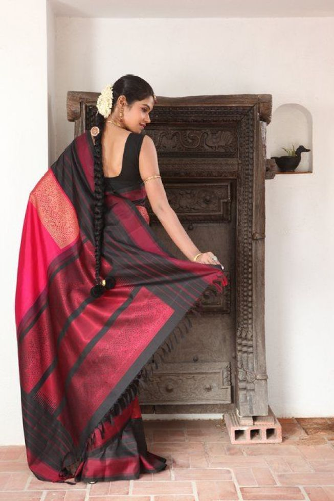 Black and a pretty shade of red; always works, especially when weaved on a kanjeevaram via