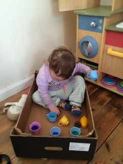 Having a tea party in a box toddler style