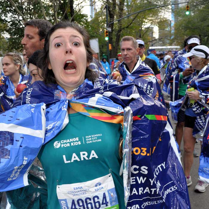 Lara with a suprised, funny expression after finishing the marathon