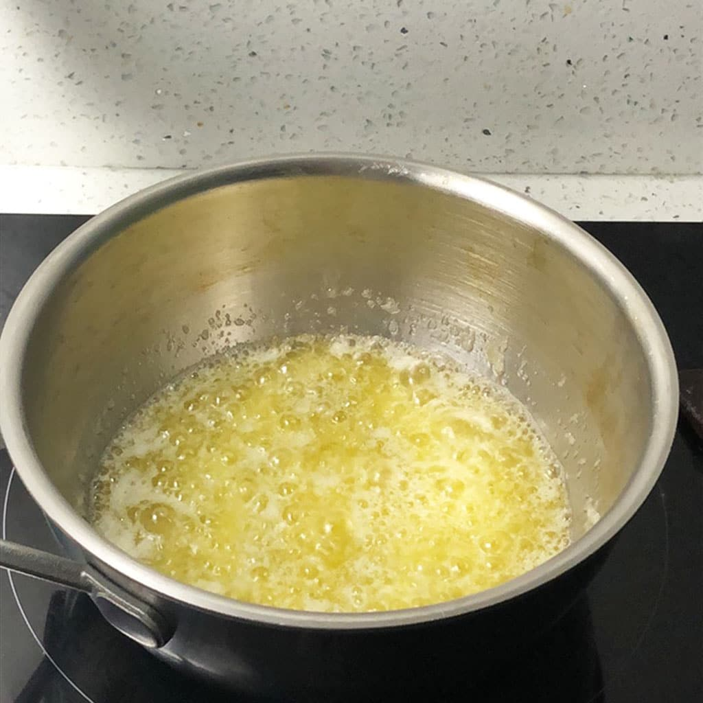 Butter boiling in a saucepan.