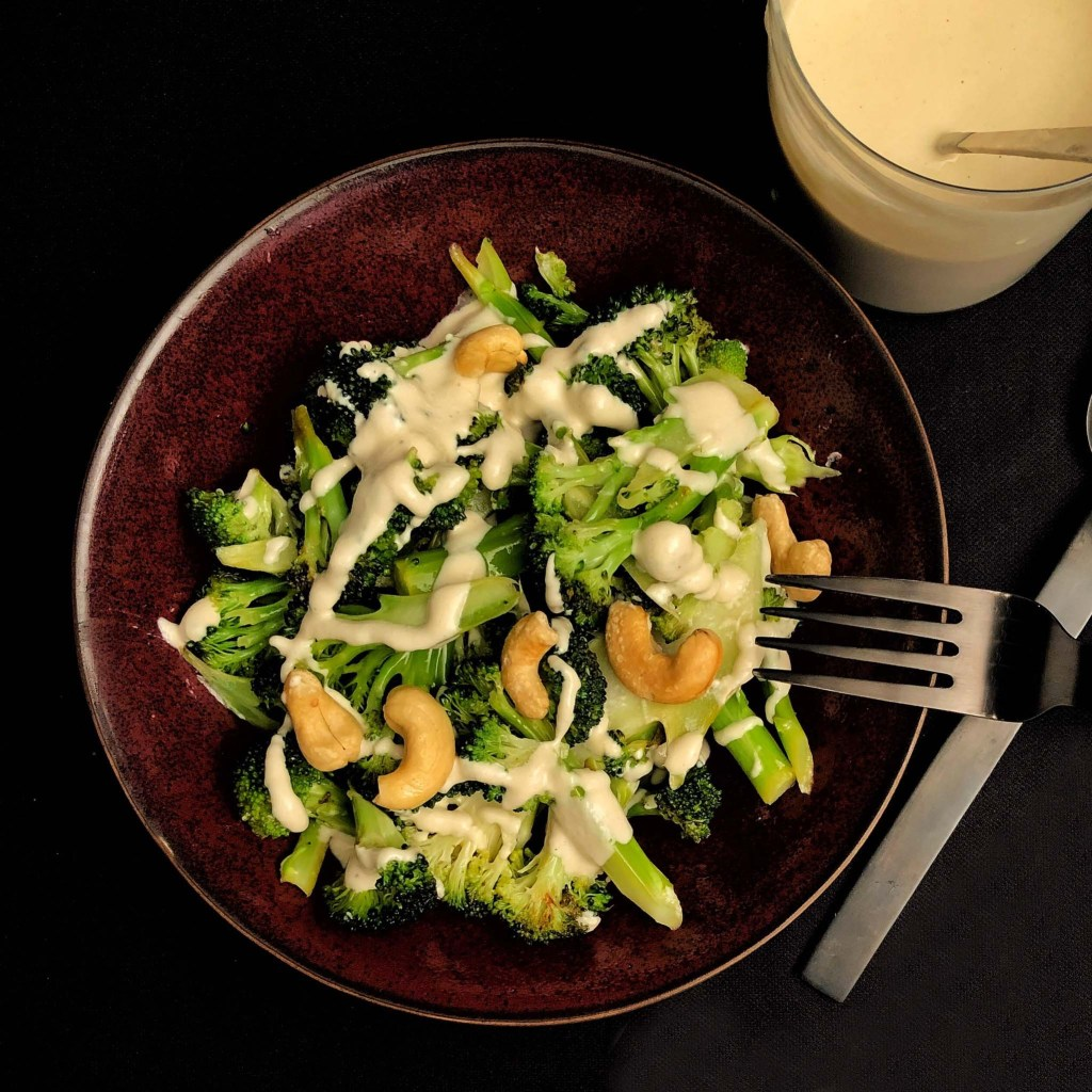A bowl of stir-fried broccoli with a creamy cashew sauce