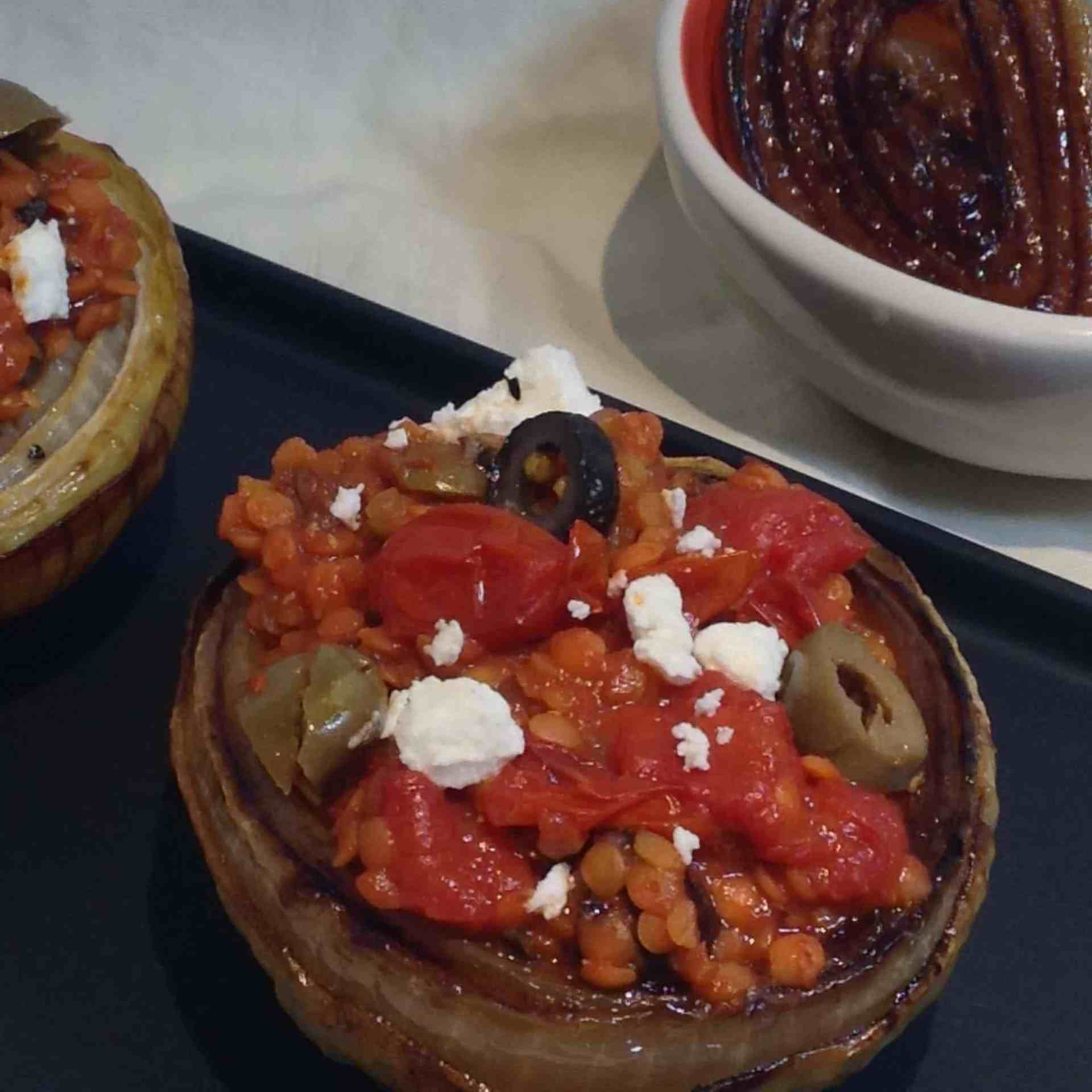 Garlicky Lentils, Olives, Roasted Tomatoes, and Feta in a Caramelized Onion Bowl