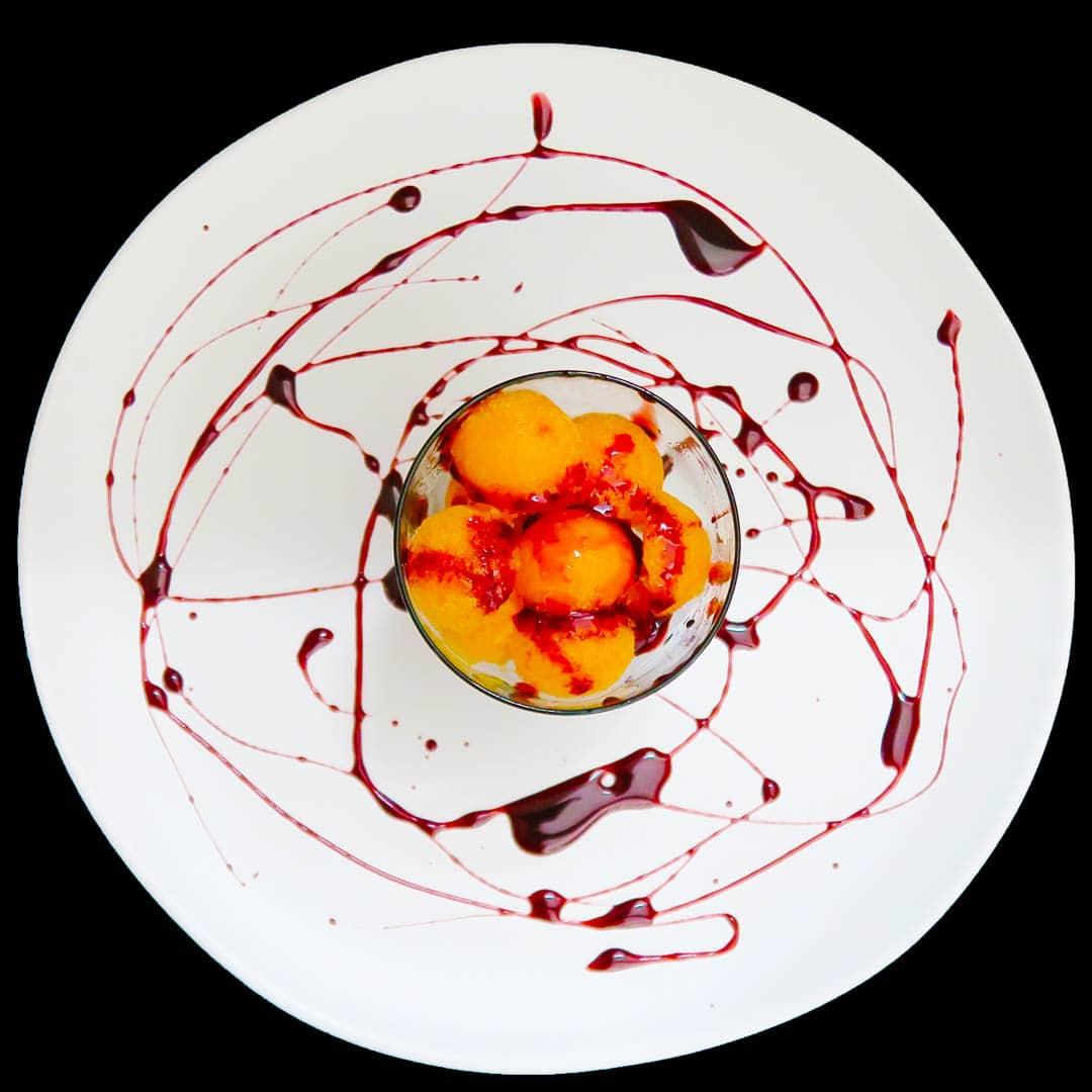 Papaya Ice with Pomegranate Reduction