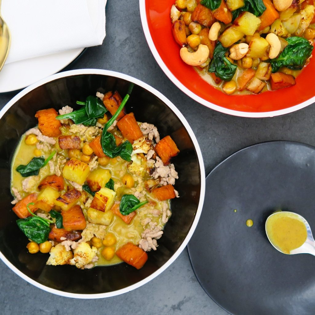 Top-down shot of two bowls of Roasted Vegetables with Curry Cream Sauce