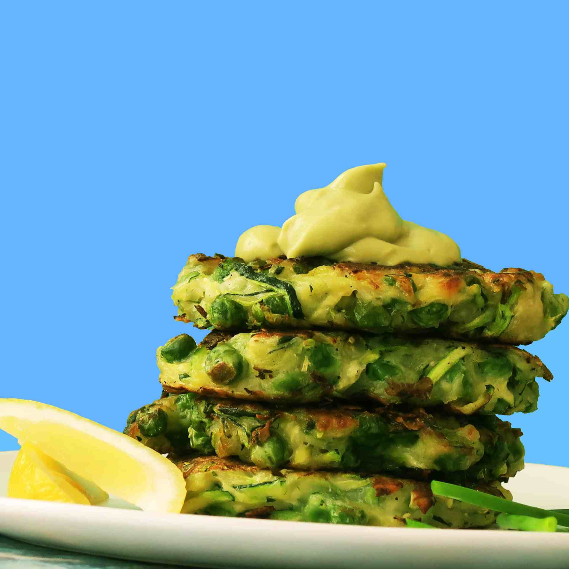 Zucchini and Green Pea Fritters with Avocado Crema {Vegan}