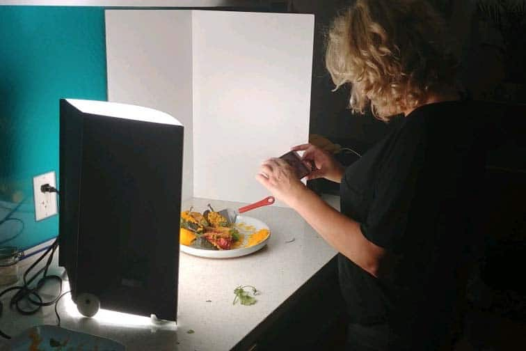 not not nutritious site owner, Sylvia Eastman taking photos of stuffed peppers