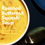 Close up of roasted butternut squash soup in a white bowl, with a gold spoon in the background.