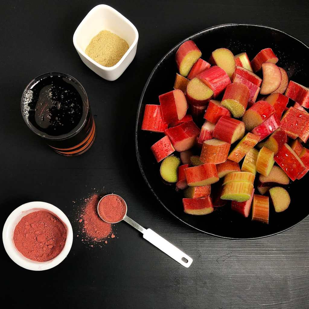 Topdown image of Maple Rhubarb Compote Ingredients: rhubarb, cardamom, maple syrup, and beetroot powder (optional).