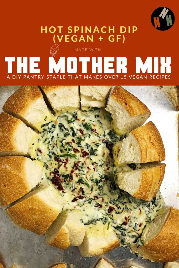 Pin for Hot Spinach Dip (Vegan and GF). Made with the Mother Mix. Image includes top-down shot of Hot Spinach Dip oozing out of a bread bowl, on a baking sheet. Dip itself is gluten-free.