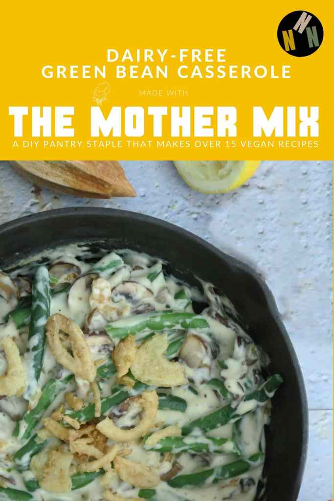 Pin for Dairy-Free Green Bean Casserole, Made with the Mother Mix, a DIY Pantry Staple that Makes Over 15 Vegan Recipes. Image shows Dairy-Free Green Bean Casserole in a skillet, showing green beans, cream sauce, mushrooms, and crispy fried onions.