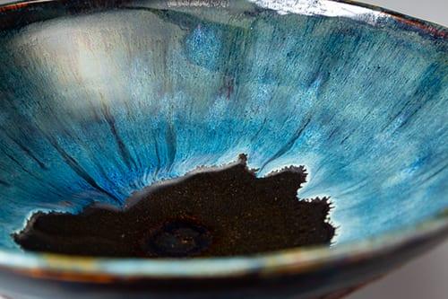 Stoneware bowl with flowing blue glaze