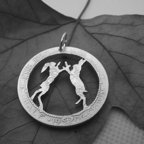 Dancing Hares on a sterling silver 1906 Half Crown