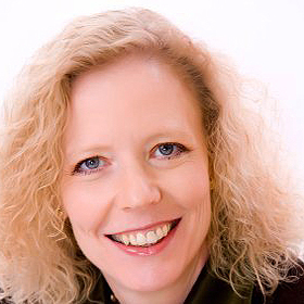 Dr. Juliann Reiland, oncoplastic breast surgeon and oncoplastics teacher