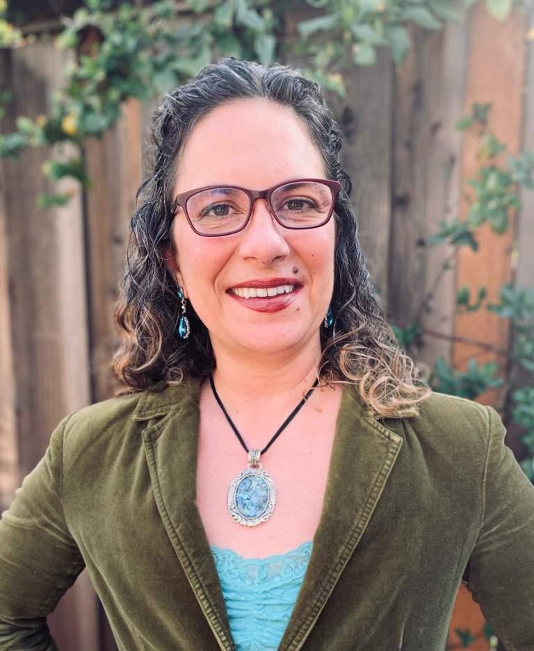 Full color portrait headshot flat advocacy nonprofit Not Putting on a Shirt NPOAS Board of Directors Christy Avila