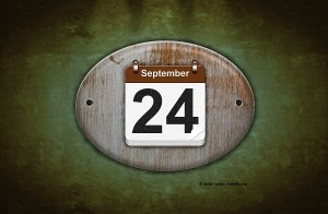 Old wooden calendar with September 24.