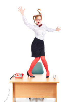 A woman frustrated from her normal desk and is ready to try a Standing Desk