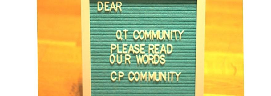 A blue letter board that reads 'dear OT community please read out words CP community'