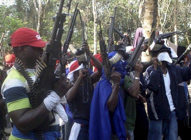 Members of the Niger Delta-based Icelanders gang brandishing weapons including a H&K G3 rifle and a HK69 grenade launcher