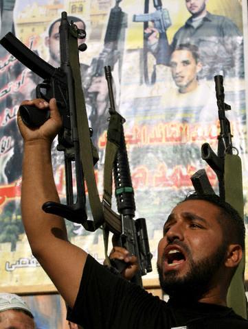 An al-Aqsa Martyrs' Brigade militiaman holding aloft a H&K MP5 submachine gun