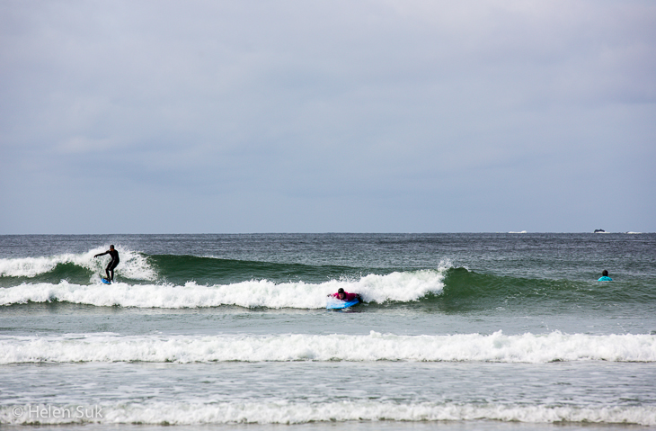 surfer rides the waves in tofino bc